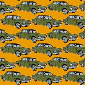 olive 1964 1965 Studebaker Lark on orange background