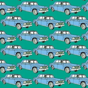 pale blue 1964 1965 Studebaker Lark Cruiser on teal background