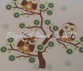 Rr3_sleepy_brown_owls_sitting_in_a_brown_tree_with_grass_comment_145182_thumb