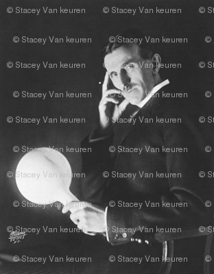 Tesla holding wireless flourescent_light_bulb
