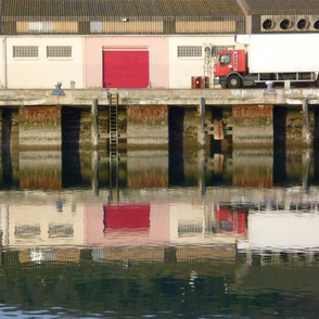 Reflections in Red at a Quiet Port