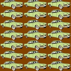 Green 1953 Studebaker Starliner on cocoa background (straight rows)