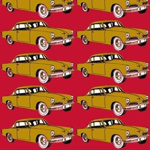 golden 1953 Studebaker on red background-ch-ch