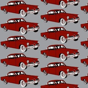 Big red 1953 Studebaker on gray background