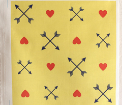 Crossed navy arrows and pink hearts