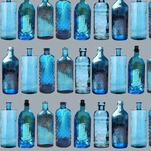 blue glass bottles on grey