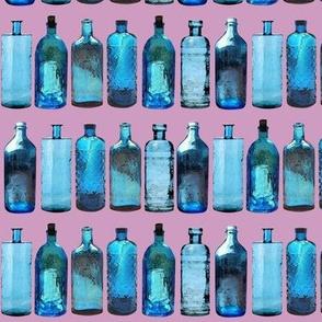 blue glass bottles on pink