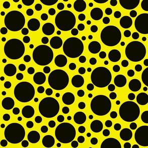 Random black dots on bright chrome yellow.