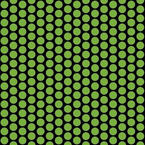 Green polka dots on a field of black