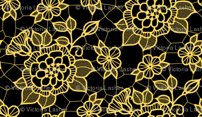 Gold lace flower on black