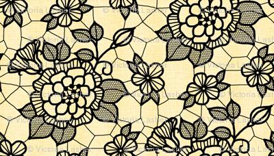 Black lace flower on pale gold