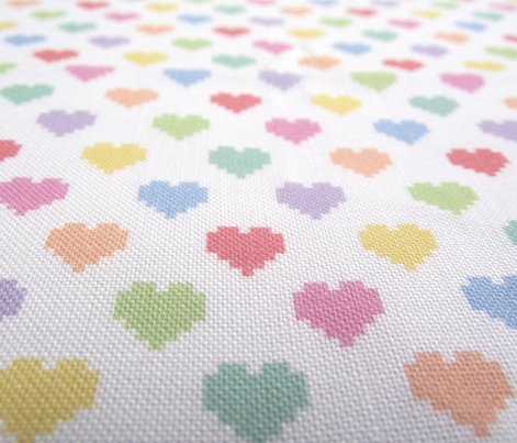 Tiny pixelated multicolored hearts
