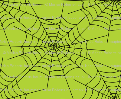 Spiderwebs on green