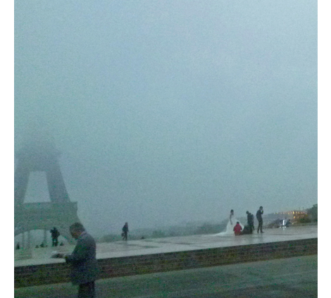 Newly Weds in front of Fogged-in Eiffel Tower