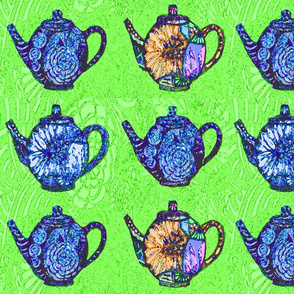 blue teapots on green