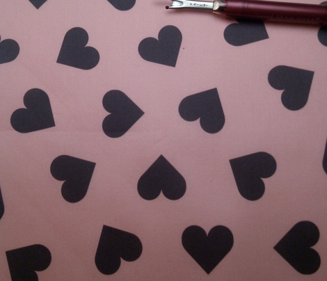 dark chocolate hearts on pink