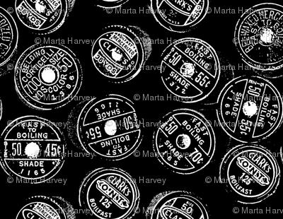 Antique spools - black and white - black background