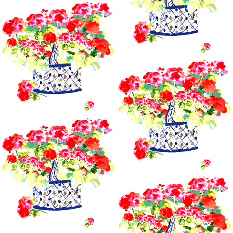 Geraniums in blue and white basket