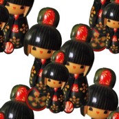 Kokeshi Dolls On White