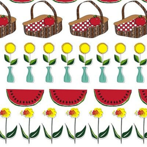 Picnic basket with watermelon and flowers