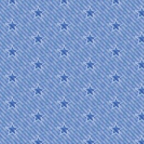 star icons on pixelated faded denim