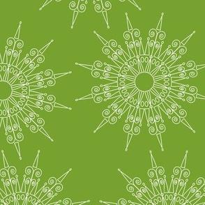 white snowflakes on green