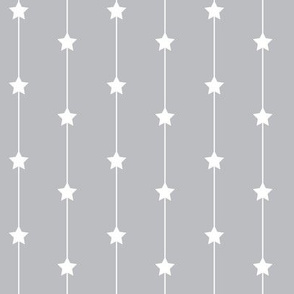 Falling stars on pale grey
