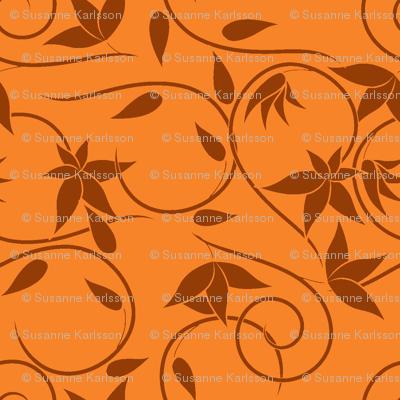 brown swirly flowers on orange