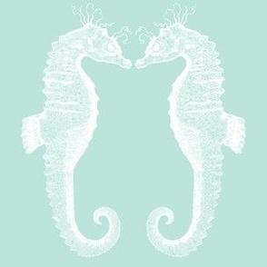 pair of kissing sea horses