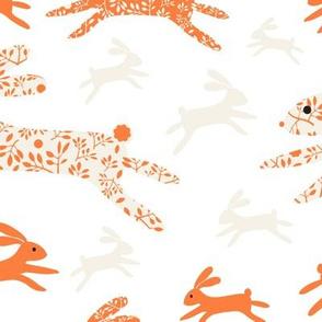 Blenheim bunnies/orange on white