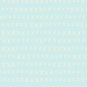 hand cross stitch on pale blue