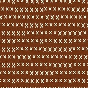 hand cross stitch on brown