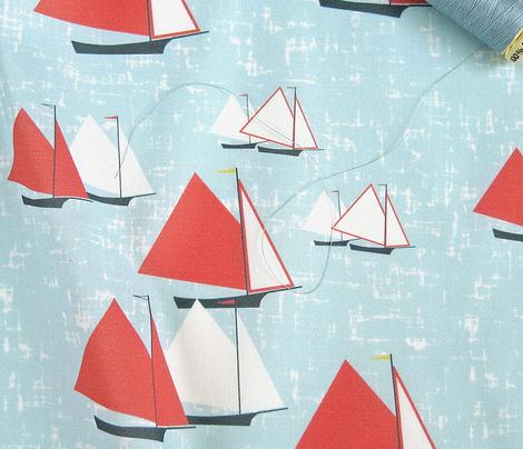 Racing gaff-rigged skiffs on sparkly blue