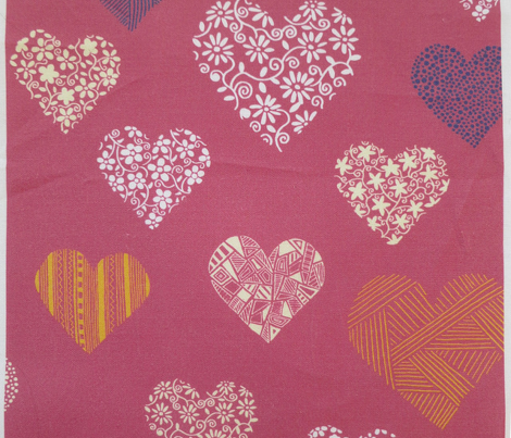 Random floral and patterned hearts on fuschia