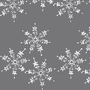 snowflake flurry on dark winter sky