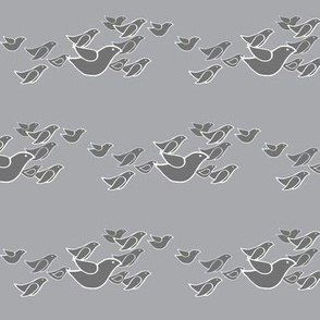 birds in flight in light monochrome