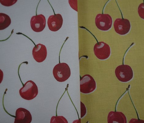 cherries on yellow