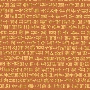 cuneiform in sunrise gold