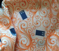 Tardis-swirl-orange-blue-on-white_comment_473058_thumb