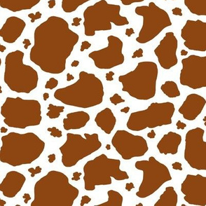 brown and white cow spots