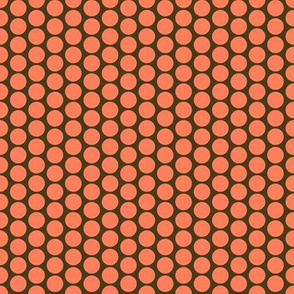 Orange polka dots on chocolate