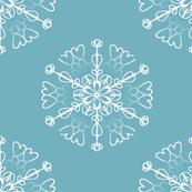 white snowflakes on teal
