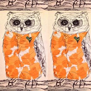 Orange owl perched large