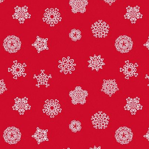 cut paper snow stars on red