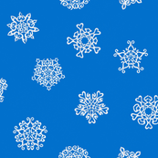 cut-paper snow stars on blue
