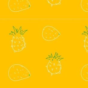 pineapples and lemons on yellow