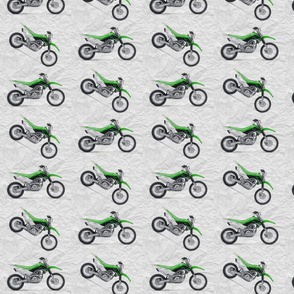 Green Dirt Bike with grey dirt background