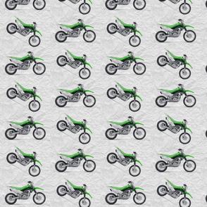 Green Dirt Bike with grey dirt background