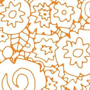white on orange wattle flower
