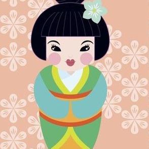 kokeshi dolls in sakura pink